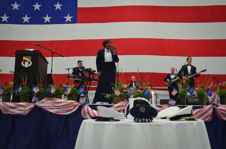 U.S. Air Force Band of Mid-America, Starlifter, based out of Scott Air Force Base, Ill. performs at the 35th annual Civic Dinner Dance in the aircraft hangar here May 14, 2015.  The Civic Dinner Dance is an event coordinated by the Milwaukee Armed Forces Committee for Wisconsin military members, elected state and local officials, and citizens of the local Milwaukee area to celebrate community relations during Armed Forces Week.  (U.S. Air National Guard photo by Tech. Sgt. Jenna Lenski/Released)