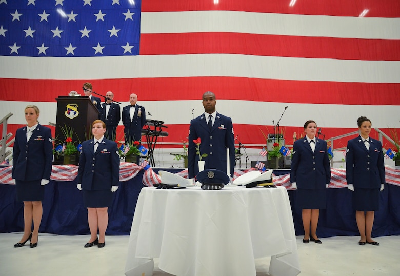 The Rising 6 Enlisted Council of the128th Air Refueling Wing performed the POW Missing Man Ceremony at the 35th annual Civic Dinner Dance in the aircraft hangar here May 14, 2015.  The Civic Dinner Dance is an event coordinated by the Milwaukee Armed Forces Committee for Wisconsin military members, elected state and local officials, and citizens of the local Milwaukee area to celebrate community relations during Armed Forces Week.  (U.S. Air National Guard photo by Tech. Sgt. Jenna Lenski/Released)