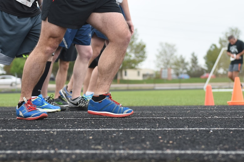 Runners from all over Team Buckley line up to race in the Dash to Distance 8k May 13, 2015, at the outdoor track on Buckley Air Force Base, Colo. The Dash to Distance series started with an 8k and will gradually increase to a 12k, 10 mile and half marathon run. Prizes were awarded to top male and female finishers, along with Commander Cup points. (U.S. Air Force photo by Airman 1st Class Samantha Meadors/Released)