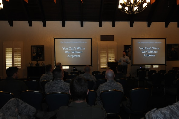 A student from Air University proposes innovative ideas to peers and professors during the Leading Edge Symposium held at the Maxwell Club, Maxwell Air Force Base, Alabama, May 7-8, 2015. During the two-day event, 15 students from Air War College, Air Command and Staff College and Squadron Officer School presented opinions and ideas on Air Force-related topics to fellow students and professors to encourage innovative thinking and acceptance of new ideas. (U.S. Air Force photo by Airman 1st Class Alexa Culbert/Cleared)