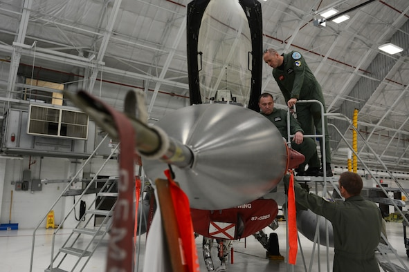 Members of the Polish Air Force spend time looking at aircraft in the phase hangar at the 115th Fighter Wing in Madison, Wis., May 4, 2015. Two pilots and three maintainers from Poland spent the week learning about the differences between their air force and the Air National Guard as a part of the State Partnership Program. (U.S. Air National Guard photo by Senior Airman Andrea F. Rhode)