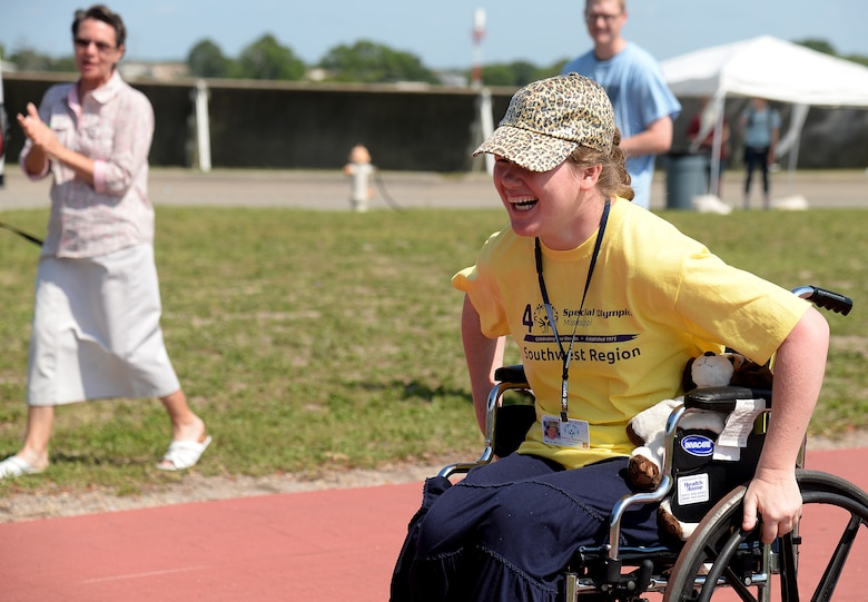 Britni Welch, Special Olympics athlete, participates in the wheelchair race at the 2015 Mississippi State Special Olympics, May 9, 2015, Keesler Air Force Base, Miss. Welch participated in the wheelchair race and tennis ball throw for her age group and won the gold medal in both sports. (U.S. Air Force photo by Senior Airman Holly Mansfield)