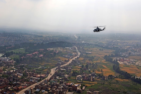 "A U.S. Marine Corps UH-1Y Huey helicopter flies over a valley en route to deliver aid and relief supplies to remote areas of the Dolakha and Sindhuli districts in Nepal May, 10, 2015, during Operation Sahayogi Haat, which means ""helping hand"" in Nepali. U.S. Marine Corps photo by Staff Sgt. Jeffrey D. Anderson"