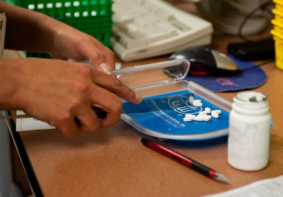 A pharmacy technician counts pills to fill a prescription at Ellsworth Air Force Base, S.D., May 22, 2012. U.S. Air Force photo by Airman 1st Class Alystria Maurer