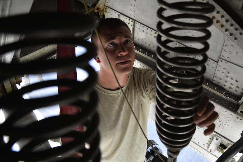 Staff Sgt. Michael inspects the retract system on the nose strut of a KC-10 Extender at an undisclosed location in Southwest Asia May 12, 2015. The retract system lowers and raises the landing gear. Michael is a crew chief assigned to the Expeditionary Aircraft Maintenance Squadron. (U.S. Air Force photo/Tech. Sgt. Christopher Boitz)