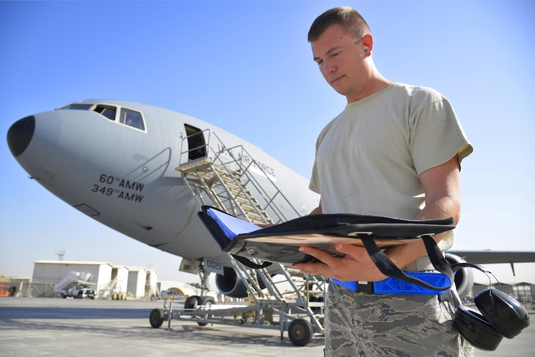 Staff Sgt. Michael reviews an inspection checklist for a KC-10 Extender at an undisclosed location in Southwest Asia May 12, 2015. Michael is a crew chief assigned to the 380th Expeditionary Aircraft Maintenance Squadron. Due to safety and security reasons, last names and unit designators were removed. (U.S. Air Force photo/Tech. Sgt. Christopher Boitz)