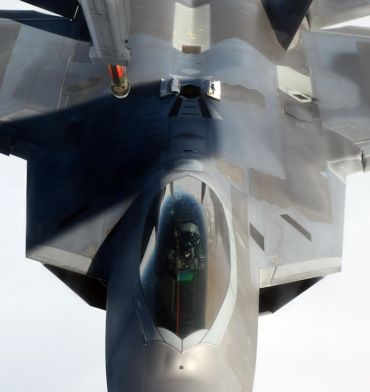 An F-22 Raptor assigned to the 525th Fighter Squadron from Joint Base Elmendorf-Richardson, Alaska, maneuvers into refueling position after conducting an air combat maneuvering sortie over Alaska, May 7, 2015. The F-22 was refueled by a KC-10 Extender from the 76th Air Refueling Squadron, at Joint Base McGuire-Dix-Lakehurst, N.J. (U.S. Air Force photo/Staff Sgt. Sheila deVera)