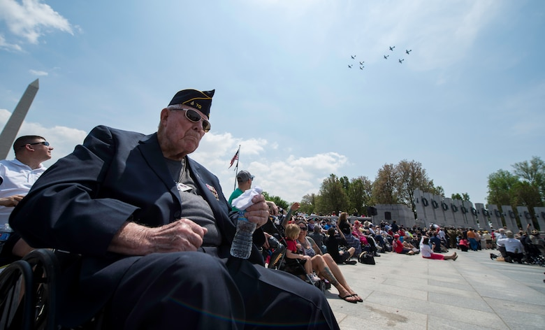 Don Egolf, a World War II veteran, watches a flyover at the National World War II Memorial in Washington D.C., May 8, 2015. The flyover was part of a 70th anniversary of V-E Day commemoration. (U.S. Air Force photo/Airman 1st Class Phillip Bryant)