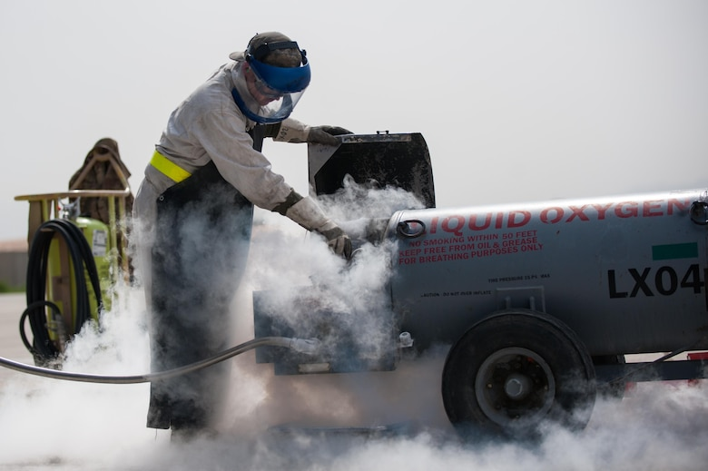 Airman 1st Class Ryan Munchel, assigned to the 455th Expeditionary Aircraft Maintenance Squadron, transfers liquid oxygen to an LOX reservoir in a C-130J Super Hercules on the flightline at Bagram Airfield, Afghanistan, May 5, 2015. The 455th EAMXS ensures C-130s on Bagram are prepared for flight and return them to a mission-ready status after they land. (U.S. Air Force photo/Tech. Sgt. Joseph Swafford)