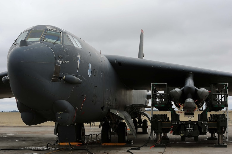 A B-52H Stratofortress sits on the flightline at Minot Air Force Base, N.D., after being loaded with air-launched cruise missiles during a Constant Vigilance aircraft generation exercise May 7, 2015. Air Force Global Strike Command routinely conducts training activities and exercises to ensure its forces are ready to perform nuclear deterrence and long-range strike operations. (U.S. Air Force photo/Senior Airman Kristoffer Kaubisch)
