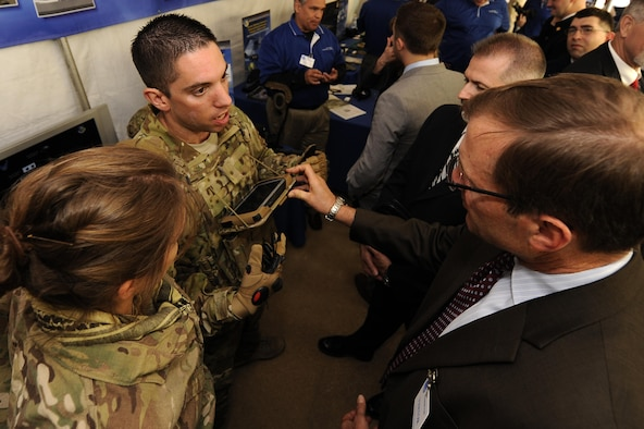 Second Lt. Anthony Eastin, behavioral scientist with the Air Force Research Laboratory, describes the capabilities of the Battlefield Air Targeting Man-Aided Knowledge (BATMAN) system, during the Department of Defense Lab Day at the Pentagon in Washington D.C. May 14, 2015. Lab Day showcases innovations from more than 60 Air Force, Army, Marines, Navy and Medical laboratories and engineering centers across the country. (U.S. Air Force photo/Tech. Sgt. Dan DeCook)