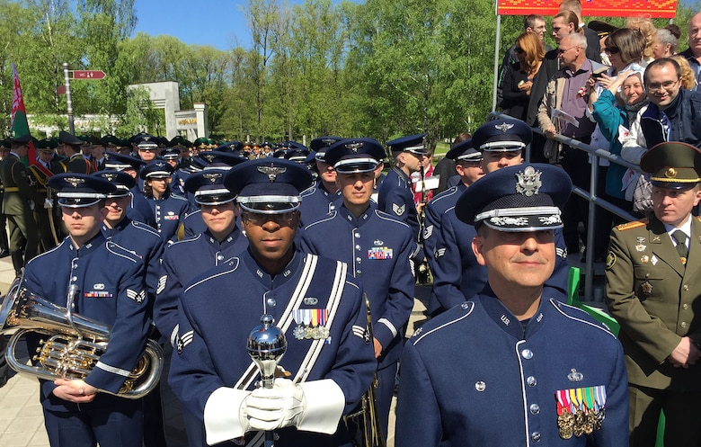 Led by Lt. Col. Mike Mench, the U.S. Air Forces in Europe Band commander, and Staff Sgt. Chris Jackson, the USAFE Band drum major, the USAFE Band gather at a staging point before marching in the World War II Victory Day Parade May 9, 2015, in Minsk, Belarus. The band's participation was the first time in Belarus' history that participants from the U.S. Defense Department marched in the parade to commemorate the sacrifices of the World War II Allies and the end of hostilities 70 years ago. In addition to their participation in the Victory Day parade, which included more than 5,000 Belarusian soldiers and 250 military vehicles, the 34 USAFE bandsmen performed concerts in Brest and Minsk, Belarus. (U.S. Air Force photo/Master Sgt. Brian Bahret)