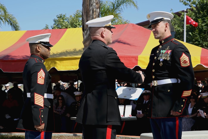 Major Gen. Joseph L. Osterman, commander, U.S. Marine Corps Forces, Special Operations Command, presents Gunnery Sgt. Brian C. Jacklin with the Navy Cross Medal, the second highest award for valor, at Marine Corps Base Camp Pendleton, Calif., April 9, 2015. Jacklin received the award in recognition of his actions during a two-day firefight with the Taliban in Helmand province, Afghanistan, which started June 14, 2012. (U.S. Marine Corps photo by Cpl. Steven Fox/Released)