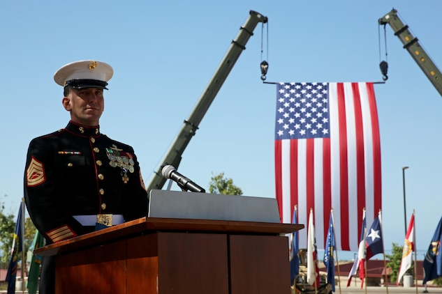 Gunnery Sgt. Brian C. Jacklin, a critical skills operator with U.S. Marine Corps Forces, Special Operations Command, delivers a speech after receiving the Navy Cross Medal at Marine Corps Base Camp Pendleton, Calif., April 9, 2015. Jacklin received the award in recognition of his actions during a two-day firefight with the Taliban in Helmand province, Afghanistan, which started June 14, 2012. (U.S. Marine Corps photo by Cpl. Steven Fox/Released)