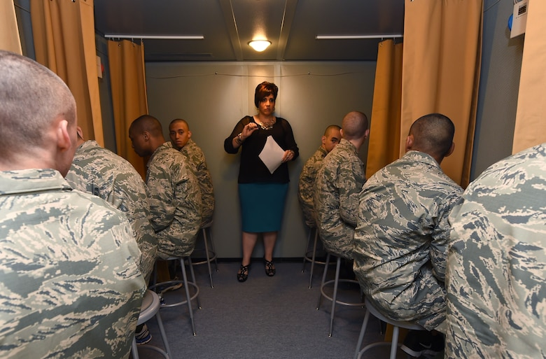 Carmen Puig-Martinez, audiology technician, instructs Basic Military Trainees of baseline hearing assessment procedures May 12, 2015, on Joint Base San Antonio-Lackland, Texas. The hearing assessment was created to provide an accurate hearing assessment of all recruits upon entering military service. (U.S. Air Force photo by Staff Sgt. Jerilyn Quintanilla)