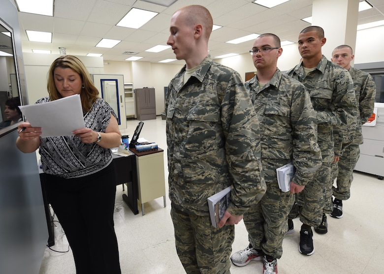 Audiology technician Tiffany Oliver verifies a Basic Military Trainee's information prior to conducting a baseline hearing assessment May 12, 2015, on Joint Base San Antonio-Lackland, Texas. Smith is part of a five-member team responsible for conducting all BMT hearing assessments. (U.S. Air Force photo by Staff Sgt. Jerilyn Quintanilla)