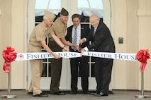 Navy Capt. Mark A. Kobelja, Commanding Officer, Naval Hospital Camp Pendleton; Brig. Gen. Edward D. Banta, Commanding General, Marine Corps Installations West - Marine Corps Base Camp Pendleton; Kenneth Fisher, chairman and chief executive officer of the Fisher House Foundation and John M. Mateczun, president of UnitedHealthcare Military and Veterans, cut the ribbon during the Fisher House opening ceremony, May 15. The new Camp Pendleton Fisher House will provide free temporary housing facilities for military families visiting wounded Marines and Sailors at the base Naval Hospital.