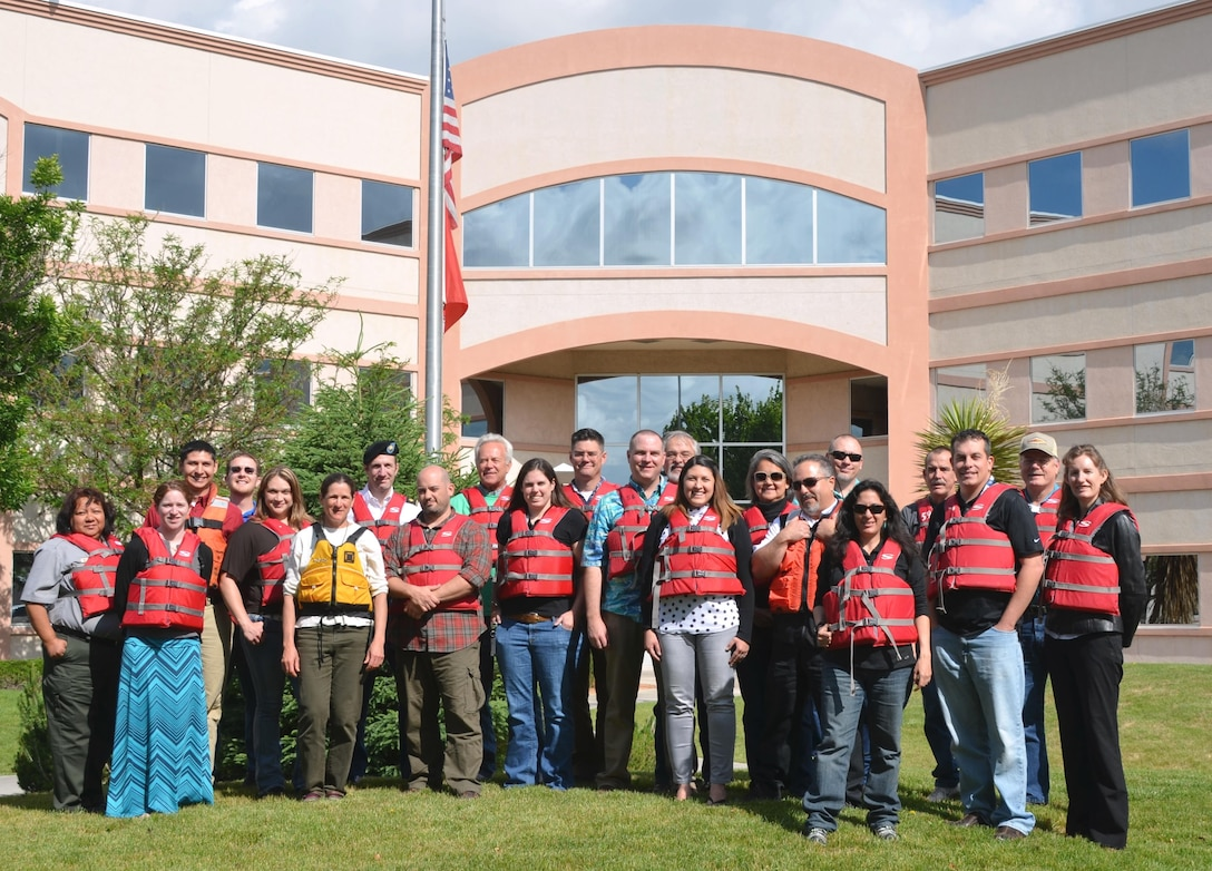 "ALBUQUERQUE, N.M. -- Approximately 25 District staff pose with their life jackets as part of the Safe Boating Council's ""Wear Your Lifejacket to Work Day"" May 15, 2015."