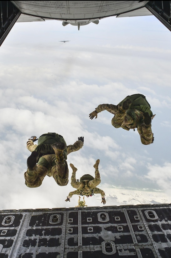Members of the 7th Special Forces Group perform a High Altitude Low Opening jump from an MC-130P Combat Shadow over Hurlburt Field, Fla., May 15, 2015. The final two MC-130P Combat Shadow aircraft in the Air Force landed for the last time at Hurlburt Field, Fla., in front of more than 400 people and will take their last flight to the boneyard at Davis-Monthan Air Force Base, Arizona, June 1. (U.S. Air Force photo/Senior Airman Jeff Parkinson)