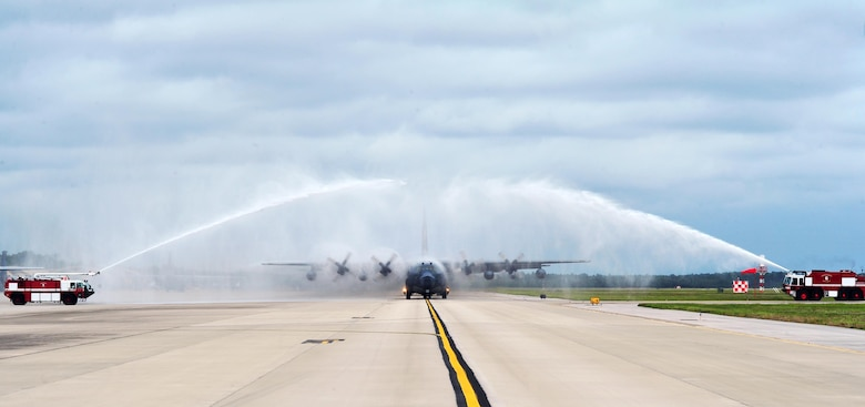 Fire trucks spray water over an MC-130P Combat Shadow after its final flight, May 15, 2015, at Hurlburt Field, Fla. The final two MC-130P Combat Shadow aircraft in the Air Force landed for the last time at Hurlburt Field, Fla., in front of more than 400 people and will take their last flight to the boneyard at Davis-Monthan Air Force Base, Arizona, June 1. (U.S. Air Force photo/Airman 1st Class Ryan Conroy)