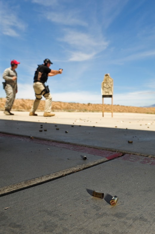 Shell casings litter the surface of the Combat Arms Training and Maintenance course during the practice round of a firing competition at Davis-Monthan Air Force Base, Ariz., May 13, 2015. The competition was held in conjunction with National Police week and consisted of several law enforcement agencies at D-M including the 355th Security Forces Squadron, Air Force Office of Special Investigations and Homeland Security Investigations. (U.S. Air Force photo by Airman 1st Class Chris Drzazgowski/Released)