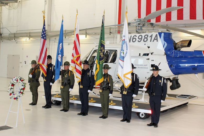 Federal and local law enforcement officers paused during a ceremony on May 15, 2015, at Selfridge Air National Guard Base, Mich., to mark Police Officers Memorial Day.  The event honored the sacrifices of their colleagues who have made the ultimate sacrifice in the line of duty. More than 130 law enforcement officers died while on duty in the U.S. in 2014.  (U.S. Air National Guard photo by Tech. Sgt. Dan Heaton)