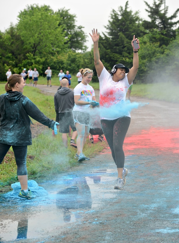 More than 280 people showed up at the Tinker Track to participate in a 5K Color Run on the morning of May 8 as part of last week's 552nd Air Control Wing Diamond Anniversary Salute. Squadron members flung colors on the runners at various stations along the course. (Air Force photo by Kelly White/Released)
