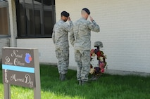 Members of the 914th Security Forces Squadron salute a memorial at the Niagara Falls Air Reserve Station on May 13, 2015. Personnel were honoring Tech. Sgt. Ian Fallon on the one-year anniversary of his death. (U.S. Air Force photo by Staff Sgt. Matthew Burke)
