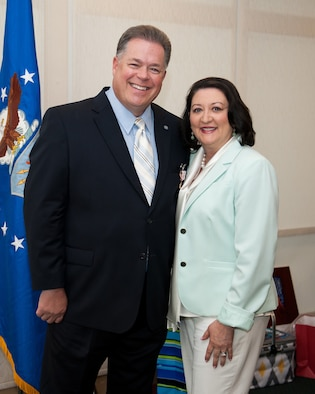 Robert Watkins, 70th ISR Wing plans and programs director, and his wife, Vikki, pose for a photo during his retirement ceremony May 30, 2015, in the Meade Conference Center at Fort George G. Meade, Md. Watkins was the director of plans and programs since 2003 and assigned to the wing during his military career since 2000. (U.S. Air Force photo/Staff Sgt. Dillon White)