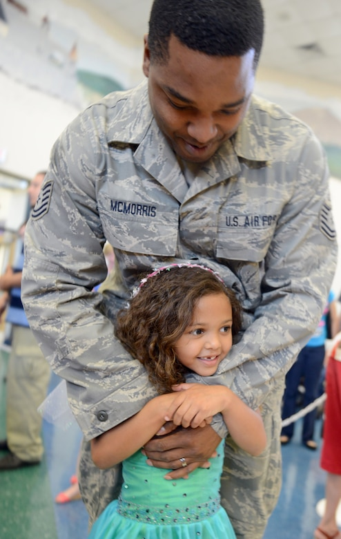 Tech. Sgt. Branden McMorris and his daughter, Kambrie, get ready to dance. (U.S. Air Force photo by Tommie Horton)