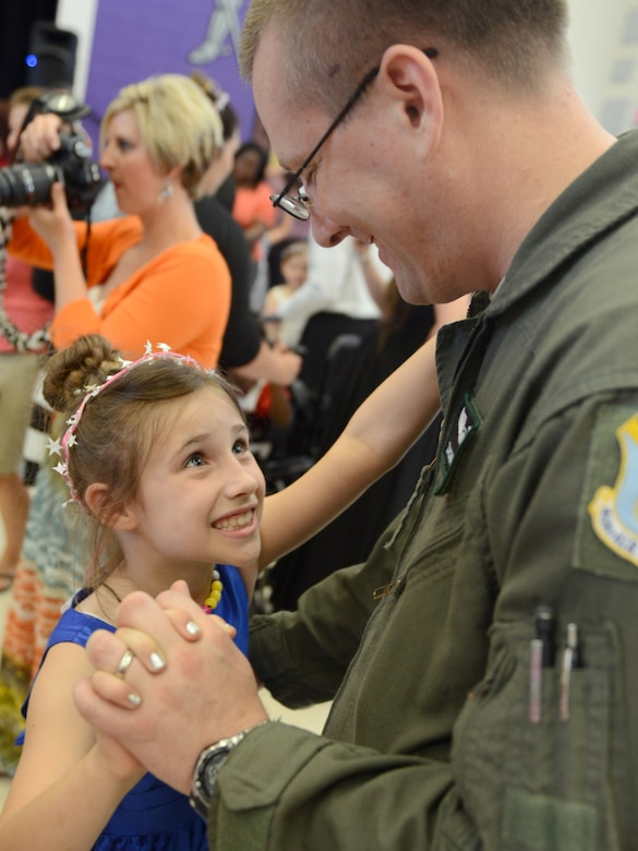 Emma Wright is all smiles as she dances with her father, Capt. Zachary Wright, during the