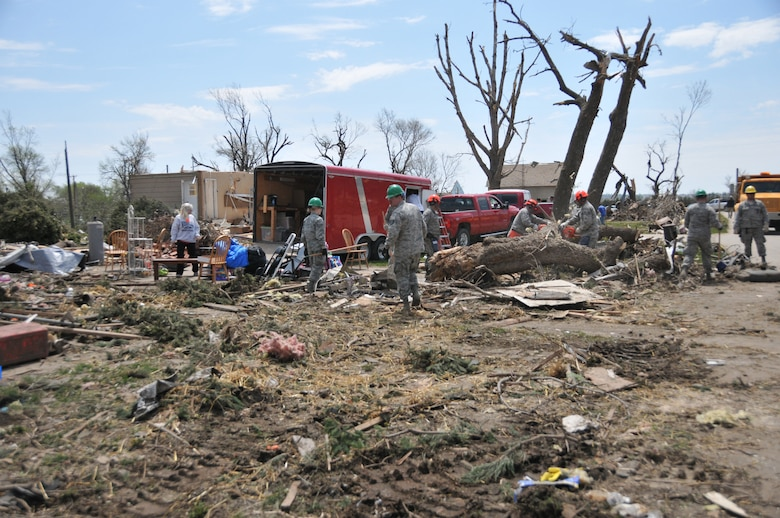 DELMONT, S.D. - Members of the 114th Civil Engineer Squadron of the South Dakota Air National Guard work alongside Delmont residents to assist with tornado recovery efforts after the city was hit by an F2 tornado on May 11, 2015.  Twenty-five members of the unit, as well as heavy equipment,  were activated for a period of up to five days to assist with the removal of large debris in the area.(National Guard photo by Senior Master Sgt. Nancy Ausland/released)