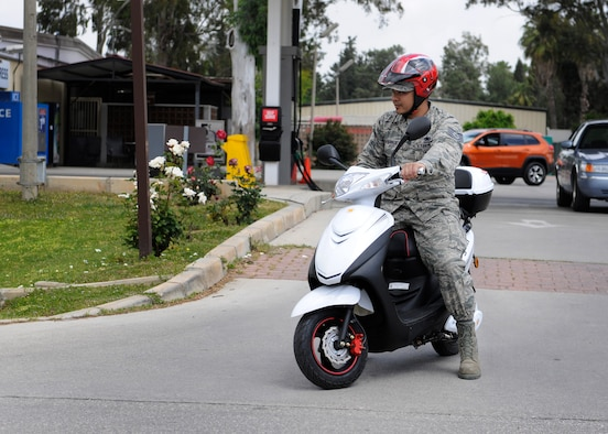 Tech. Sgt. Richard Villa-Ignacio, 39th Logistics Readiness Squadron NCO in-charge of inventory section, rides on a moped May 1, 2015, at Incirlik Air Base, Turkey. Many patrons of Incirlik choose to ride electric bikes or mopeds around base an alternative to walking or driving cars. (U.S. Air Force photo by Senior Airman Krystal Ardrey/Released)