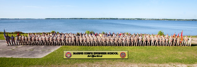 Marines, civilians, and contractors stand for the Marine Corps Engineer School command photograph.
