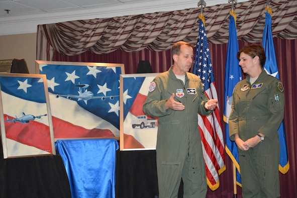Col. Jay Bickley, commander of the 552nd Air Control Wing at Tinker Air Force Base, thanks Gen. Lori Robinson, commander of Pacific Air Forces, for attending the wing's Diamond Anniversary kickoff reception May 7 at the Tinker Club. Colonel Bickley presented the general with a commemorative coin.  (Air Force photo by Darren D. Heusel/Released)