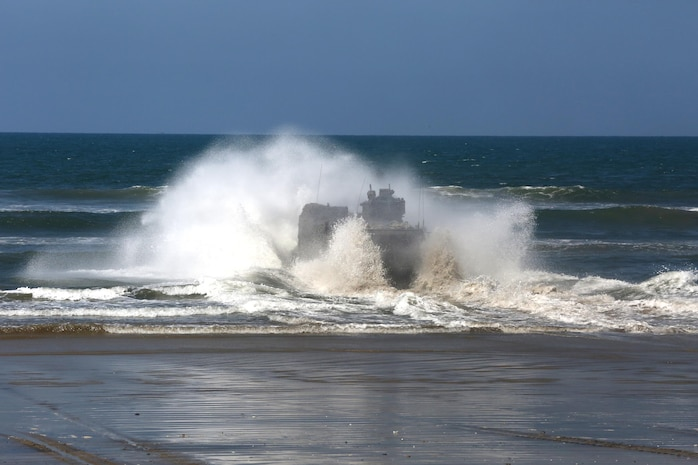An Amphibious Assault Vehicle with AAV Platoon, Company B, Ground Combat Element Integrated Task Force, splashes into the Pacific Ocean during a Marine Corps Operational Test and Evaluation Activity assessment May 10, 2015, at Red Beach training area, aboard Marine Corps Base Camp Pendleton, California. The GCEITF AAV Platoon is executing the final phase of their Marine Corps Operational Test and Evaluation Activity assessment by conducting beach and water-borne tasks. From October 2014 to July 2015, the GCEITF will conduct individual and collective level skills training in designated ground combat arms occupational specialties in order to facilitate the standards-based assessment of the physical performance of Marines in a simulated operating environment performing specific ground combat arms tasks. (U.S. Marine Corps photo By Gunnery Sgt. Matt Epright/Released)
