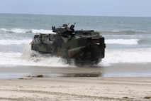 An Amphibious Assault Vehicle with AAV Platoon, Company B, Ground Combat Element Integrated Task Force, splashes ashore during a pilot test May 9, 2015, at Red Beach training area, aboard Marine Corps Base Camp Pendleton, California. The GCEITF AAV Platoon is executing the final phase of their Marine Corps Operational Test and Evaluation Activity assessment by conducting beach and water-borne tasks. From October 2014 to July 2015, the GCEITF will conduct individual and collective level skills training in designated ground combat arms occupational specialties in order to facilitate the standards-based assessment of the physical performance of Marines in a simulated operating environment performing specific ground combat arms tasks. (U.S. Marine Corps photo By Gunnery Sgt. Matt Epright/Released)