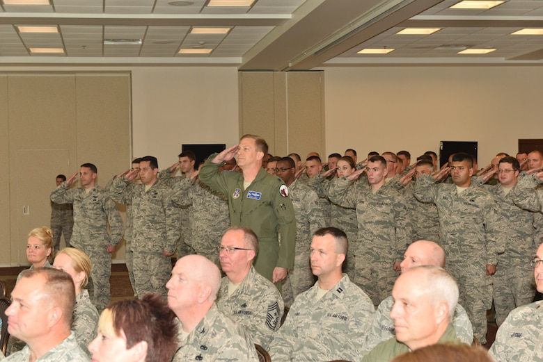 Lt. Col. Chris Thurn, 107th Operations Support Squadron Commander, renders the first salute to Lt. Col. Gary R. Charlton II as commander of the 107th AW Operations Group during a change of command ceremony at Niagara Falls Air Reserve Station, May 16, 2015.