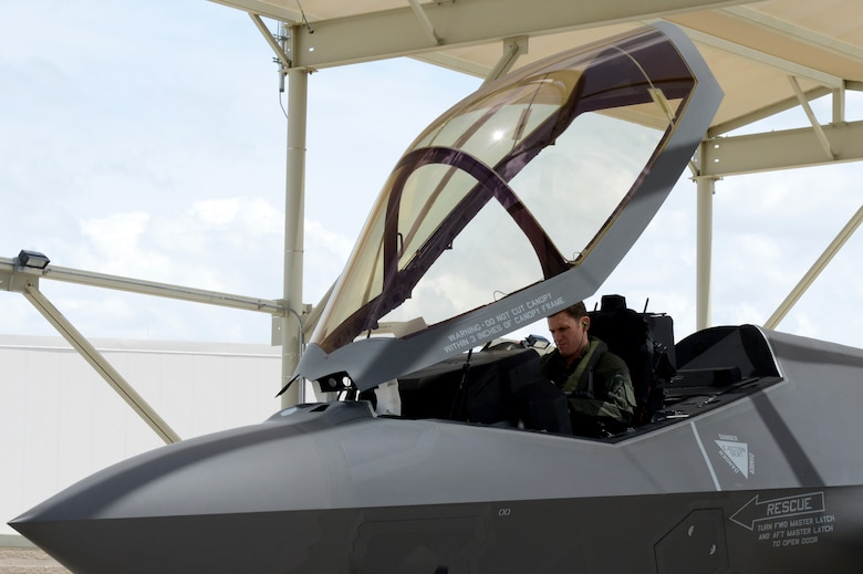 Royal Australian Air Force Maj. Andrew Jackson, 61st Fighter Squadron RAAF squadron leader, performs pre-flight checks in a RAAF F-35 A Lightning II at Luke Air Force Base, Arizona, May 14, 2015. Pre-flight checks help ensure the aircraft is fit and flight ready. Jackson was the first Australian pilot to fly the RAAF F-35 at Luke. (U.S. Air Force photo by Senior Airman James Hensley)