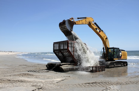 The U.S. Army Corps of Engineers and its contractor Great Lakes Dredge and Dock Company rinse a screening basket after pumping sand onto Ocean City as part of the Great Egg Harbor Inlet to Townsends Inlet coastal storm damage reduction project.