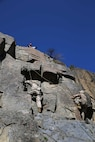 Marines with the Ground Combat Element Integrated Task Force climb a 40-foot cliff face during the final Marine Corps Operational Test and Evaluation Activity assessment aboard Marine Corps Mountain Warfare Training Center Bridgeport, California, May 18, 2015. From October 2014 to July 2015, the GCEITF will conduct individual and collective level skills training in designated ground combat arms occupational specialties in order to facilitate the standards-based assessment of the physical performance of Marines in a simulated operating environment performing specific ground combat arms tasks. (U.S. Marine Corps photo by Cpl. Paul S. Martinez/Released)