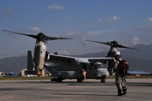 U.S. Air Force Master Sgt. Joe Damian, 36th Contingency Response Group independent duty medical technician-paramedic, walks to a U.S. Marine Corps MV-22 Osprey for a casualty evacuation mission at the Tribhuvan International Airport in Kathmandu, Nepal, May 14, 2015. Damian flew on nine sorties in three days with the Marines in support of Operation Sahayogi Haat and transported a total of six patients following the second earthquake the struck Nepal May 12, 2015. (U.S. Air Force photo by Staff Sgt. Melissa B. White/Released)