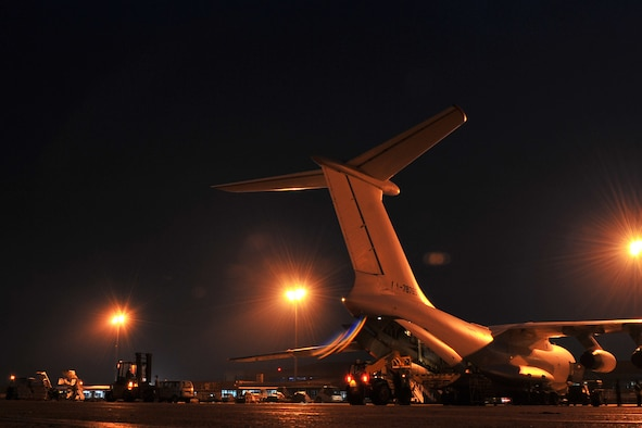 U.S. Air Force 36th Contingency Response Group Airmen unload relief supplies from an Ilyushin IL-76 cargo aircraft at the Tribhuvan International Airport in Kathmandu, Nepal, May 8, 2015. The Airmen arrived in Nepal May 5, 2015, to assist the government of Nepal and U.S. Agency for International Development to process relief supplies following a devastating earthquake and have helped process more than 4 million pounds of cargo as of May 16, 2015. (U.S. Air Force photo by Staff Sgt. Melissa B. White/Released)
