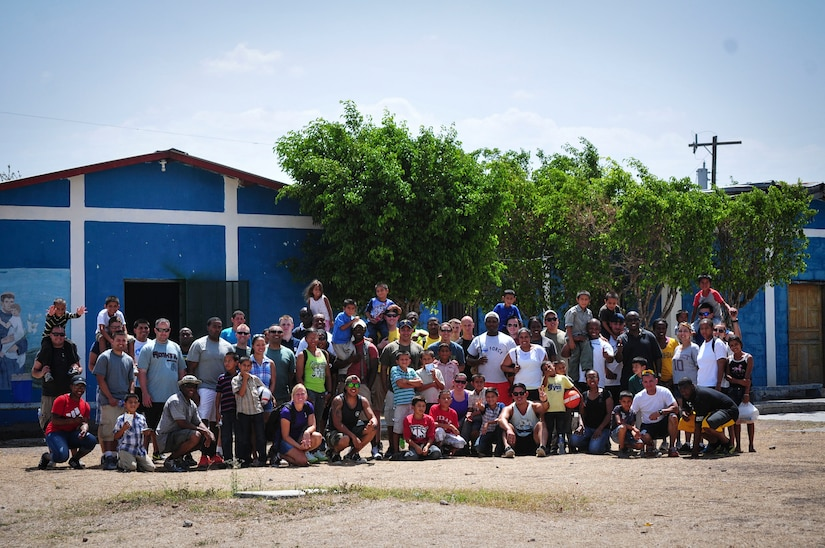 Volunteers from Joint Task Force-Bravo pose for a group photo with boys from the Saint Anthony of Padua Boys Home outside La Paz, Honduras May 16, 2015. The 1st Battalion, 228th Aviation Regiment from Soto Cano Air Base leads monthly visits to local orphanages around Soto Cano Air Base, to serve the community. (U.S. Air Force photo by Capt. Christopher Love)