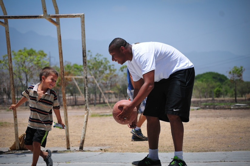U.S. Air Force Staff Sgt. Shawn Gregoire, 612th Air Base Squadron noncommissioned officer in charge of transient alert, plays basketball with a boy from the Saint Anthony of Padua Boys Home outside La Paz, Honduras May 16, 2015. Gregoire volunteered his Saturday morning to spend time with the orphans there. (U.S. Air Force photo by Capt. Christopher Love)