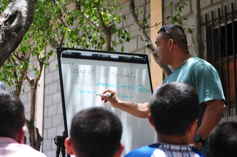 U.S. Army Chaplain (Capt.) Vincente Alcivar, 1st Battalion, 228th Aviation Regiment chaplain, teaches Army values, including respect, selfless service and honor, to the boys of Saint Anthony of Padua Boys Home outside La Paz, Honduras May 16, 2015. The 1-228 leads monthly visits to local orphanages around Soto Cano Air Base, to serve the community. (U.S. Air Force photo by Capt. Christopher Love)