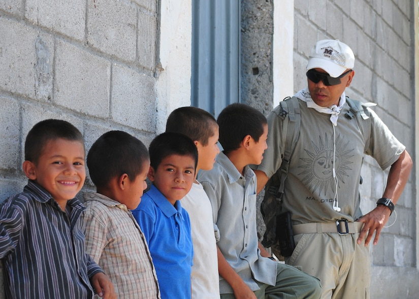 U.S. Army Sgt. Tia Sokimson, American Forces Network Honduras combat videographer, speaks with a row of boys from the Saint Anthony of Padua Boys Home outside La Paz, Honduras May 16, 2015. Sokimson volunteered to spend his morning with the boys as part of a monthly orphanage visit sponsored by the 1st Battalion, 228th Aviation Regiment from Soto Cano Air Base. (U.S. Air Force photo by Capt. Christopher Love)