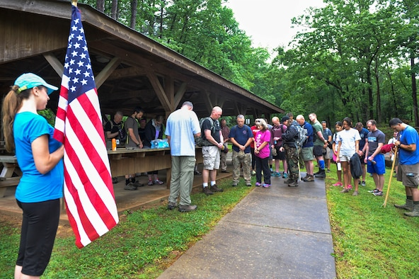 Chaplain (Lt. Col.) Herbert Hodde, 188th Wing chaplain, leads Airmen and families in a prayer at the start of the 50 Summit Challenge May 8, 2015, at Mount Magazine State Park, Ark. The 50 Summit challenge was designed for Airmen to proudly display the Air Force flag from the highest points in each of our 50 states as well have fun, expand personal boundaries and get outdoors. (U.S. Air Force photo by Senior Airman Stephanie Serrano)