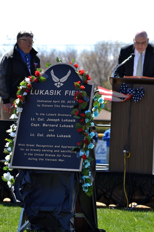 A dedication ceremony for the ball field April 25, 2015 at Dickson City, Pa.'s Crystal Park, pays honor to three Air Force aviator brothers from the town. The plaque bearing their names will be mounted appropriately on the flag pole beyond the center field fence. (U.S. Air National Guard photo by Master Sgt. Christopher Botzum/Released)