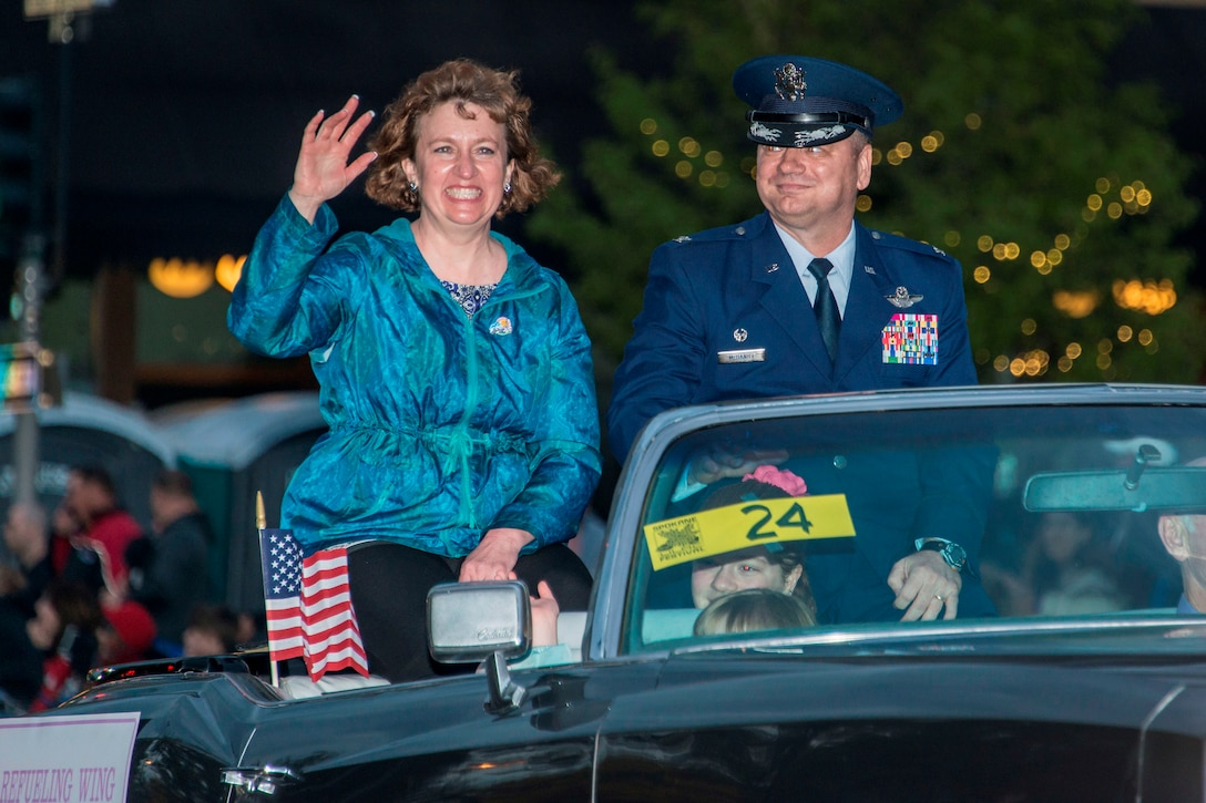 Col. Brian McDaniel, 92nd Air Refueling Wing commander, and his wife, Deborah, wave at crowds from their classic car during the 77th Annual Spokane Lilac Festival Armed Forces Torchlight Parade May 16, 2015, in downtown Spokane, Wash. This parade affords community members an opportunity to remember the sacrifice and service of the nation's military men and women and respect the rich heritage of the Inland Northwest, past and present. (U.S. Air Force photo/Staff Sgt. Benjamin W. Stratton)